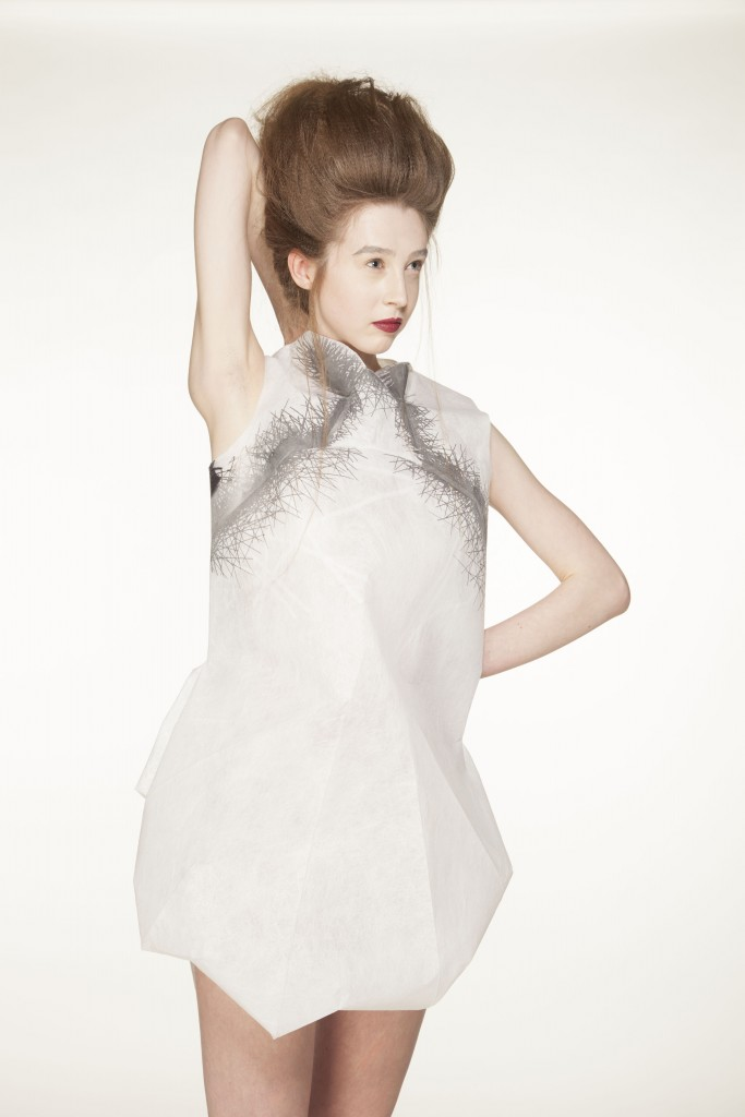 White sleeveless dress made from Lutradur 100 with a dark thermochromic textile print, activated by body temperature