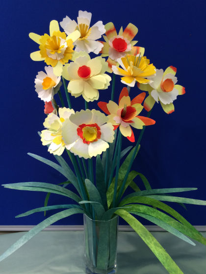 A dozen Evolon daffodils made in an assorted shades of yellow, white, cream and orange, surrounded by long green leaves made out of Lutradur.