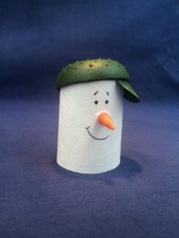 Snowman made using Evolon, painted face and small carrot shaped nose, wearing a painted green cap