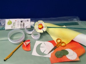 Items required to make the daffodils, including white fluted pastry cutters, scissors, transfer painted Evolon, a pack of green garden canes and a pencil.