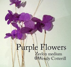 Approximately nine simple purple flowers made up of four or five petals attached to fine copper wire stems.