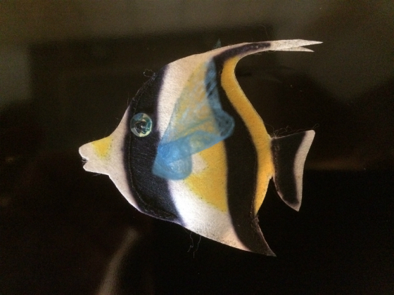 A black, yellow and white striped Moorfish made out of Zeelon Heavy, with transparent blue fins and a bright sequin eyes.