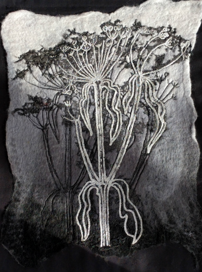 A picture in relief of two images of cow parsley, one black and one white on a grey background