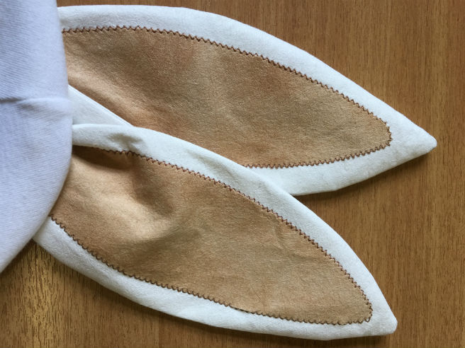 A pair of white rabbit ears made from Evolon, with light brown inner ear sections machine stitched to the front.