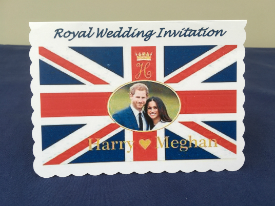 An image of the Union Jack with a picture of Harry and Meghan in the centre, with the wording 'Royal Wedding Invitation' at the top.