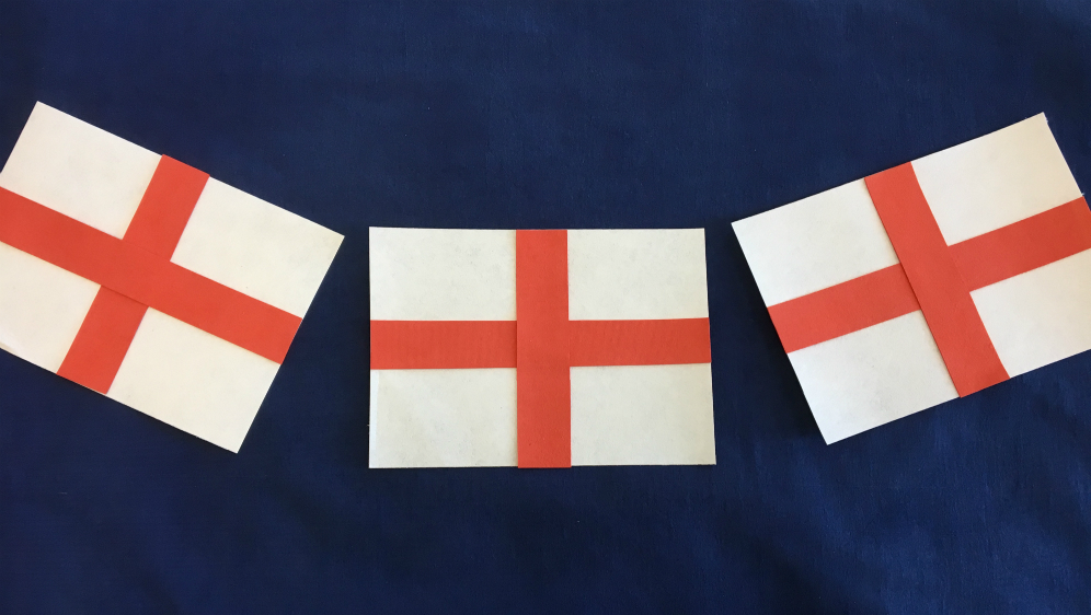 Three England flags made from Evolon with strips of red dyed Evolon to form the St George cross.