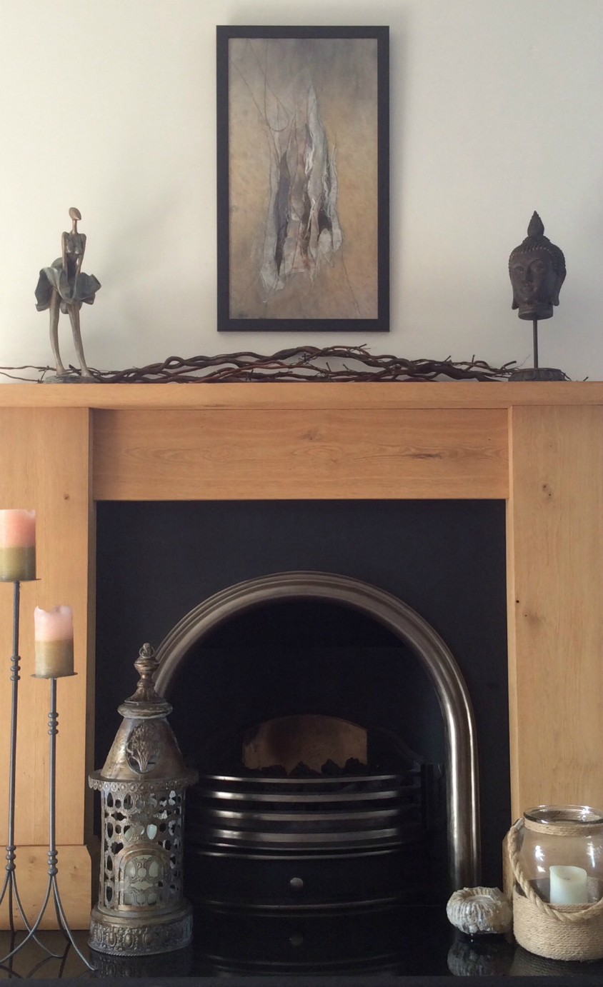 Photograph of Karen's picture hanging above a Victorian style fireplace.