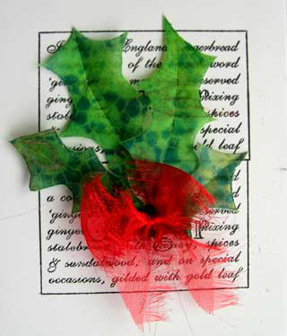 Four holly leaves and bow made from Zeelon against a black and white printed background