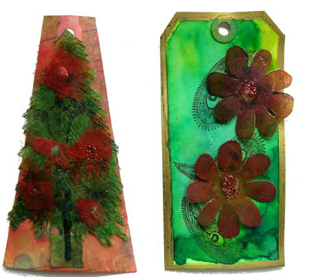 Two gift tags, a little 3D Christmas tree with red decorations on a pinkish background, the other shaped like a luggage tag and has a green background and two brown daisy type flowers on the front.