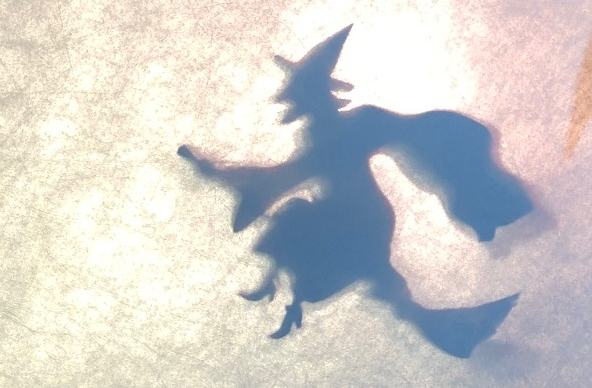 Shadow puppet of a witch on a broomstick
