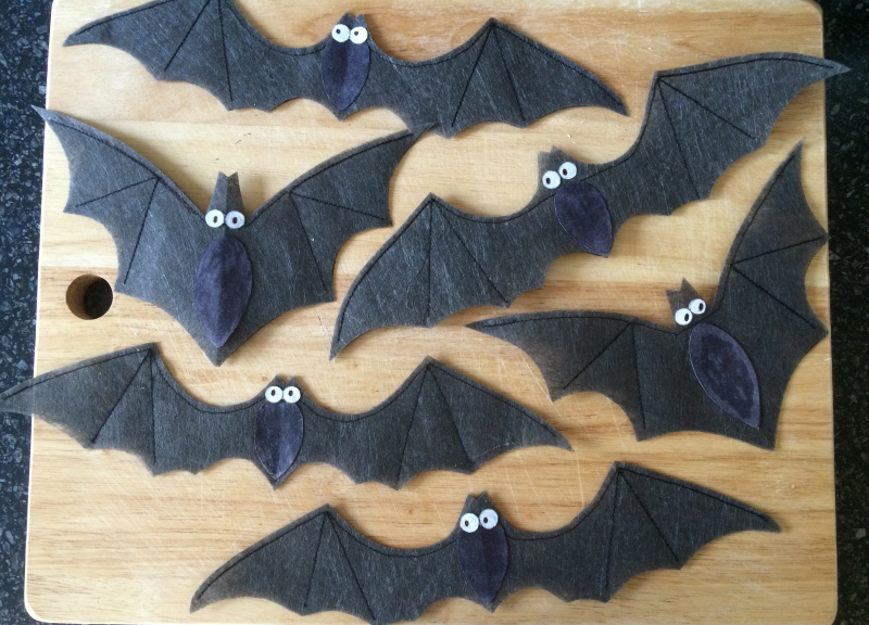 A collection of six bats of two different designs, some with their wings pointing upwards, others with their wings outstretched.